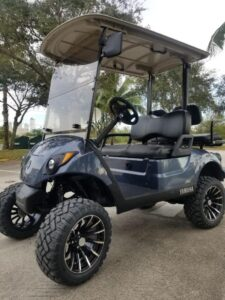 A private golf cart parked in a gated community.