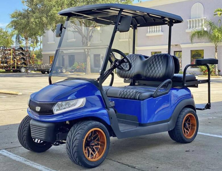 A privately owned golf cart parked at a resort and golf course.