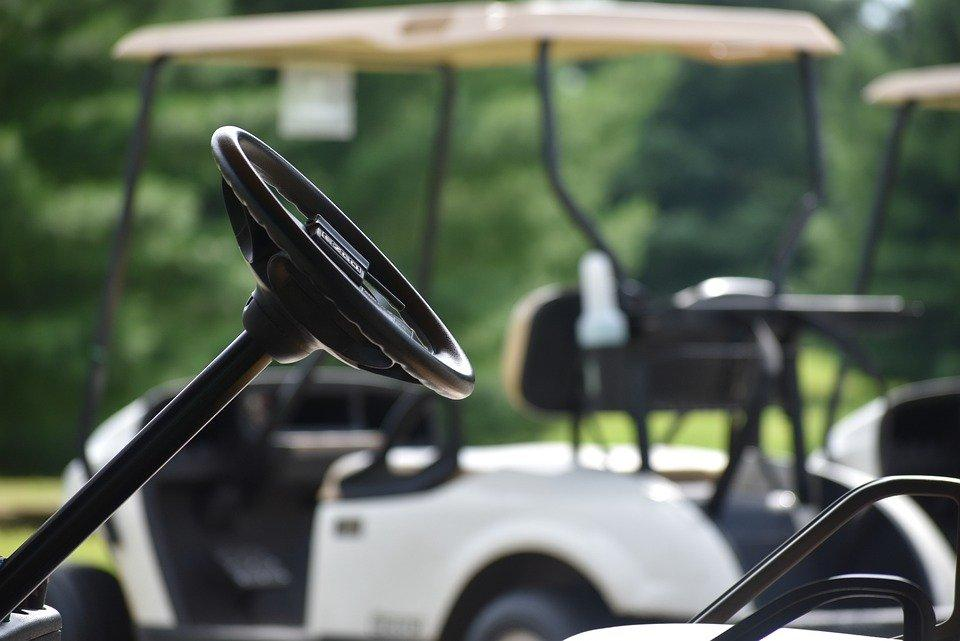A close up of a golf cart steering wheel