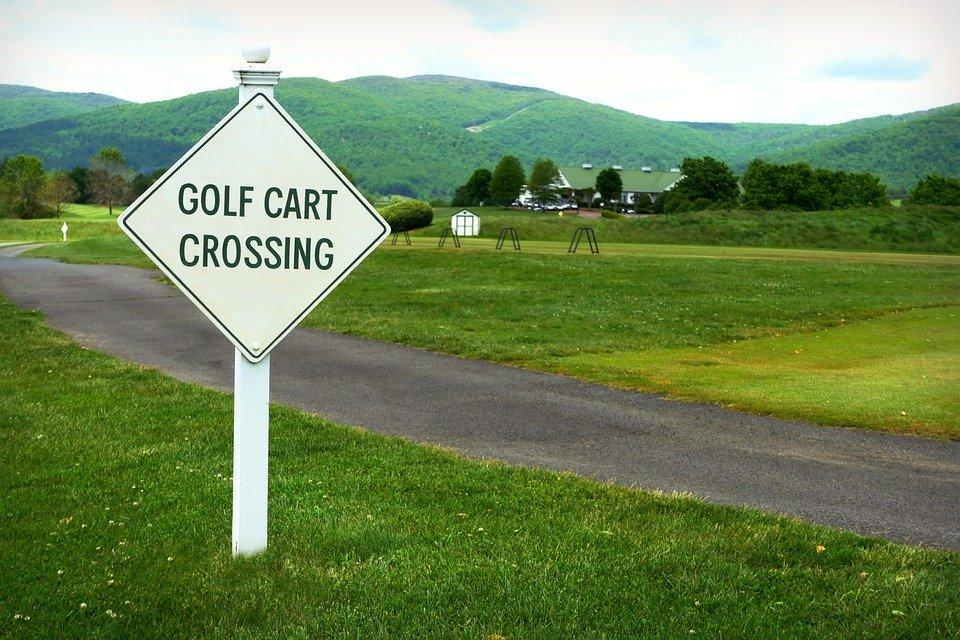 A signboard for golf cart crossing
