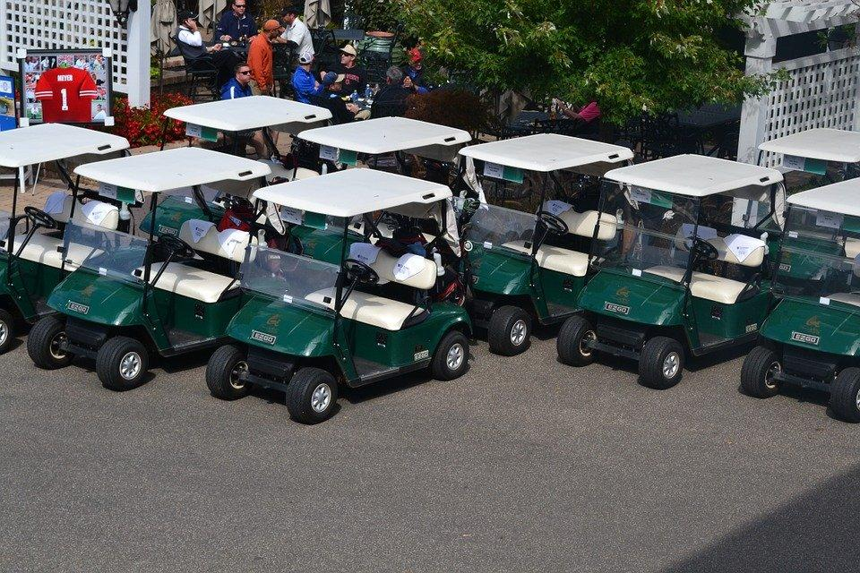 golf carts lined up outside a dealership